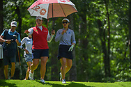 Ariya Jutanugarn (THA) and Su Oh (AUS) watch a photographer take a spill off the hill as they head down 2 during round 3 of the U.S. Women's Open Championship, Shoal Creek Country Club, at Birmingham, Alabama, USA. 6/2/2018.<br /> Picture: Golffile | Ken Murray<br /> <br /> All photo usage must carry mandatory copyright credit (© Golffile | Ken Murray)