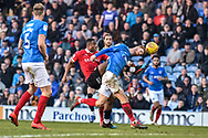 Portsmouth Midfielder, Tom Naylor (7) heads away a chance fro Barnsley Forward, Victor Adeboyejo (29) during the EFL Sky Bet League 1 match between Portsmouth and Barnsley at Fratton Park, Portsmouth, England on 23 February 2019.