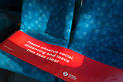 Seats on a London bus is blocked off to prevent passengers sitting within proximity of others on the day that UK Prime Minster, Boris Johnson announced in parliament of a major easing of Coronavirus pandemic restrictions on July 4th next week, including the re-opening of pubs, restaurants, hotels and hairdressers in England, on 23rd June 2020, in London, England. The three month two metre social distance will be also reduced to one metre plus but in the last 24hrs, a further 171 have died from Covid, bringing the UK total to 42,927.