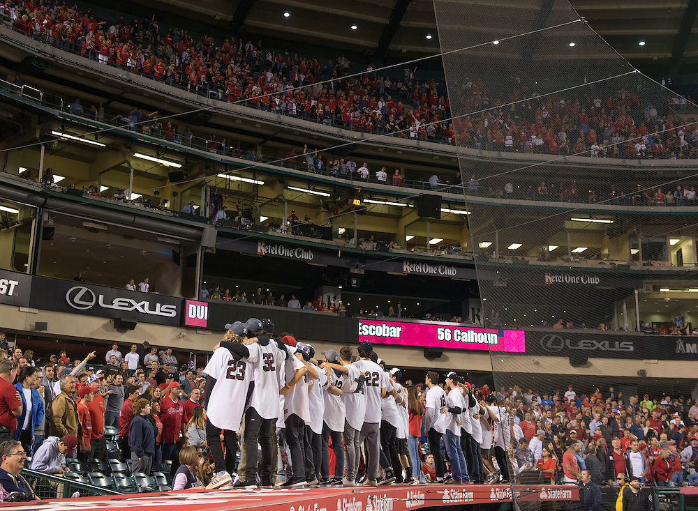 The Laguna Beach Breakers baseball team is recognized for their Division 4 championship during the seventh inning stretch Tuesday night at Angel Stadium.<br /> <br /> ///ADDITIONAL INFO:   <br /> <br /> angels.0615.kjs  ---  Photo by KEVIN SULLIVAN / Orange County Register  -- 6/14/16<br /> <br /> The Los Angeles Angels take on the Minnesota Twins Tuesday at Angel Stadium.