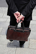 businessman with briefcase waiting