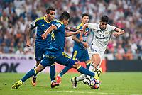 Real Madrid's player Marco Asensio and Celta de Vigo's player Fabian Ariel Orellana during a match of La Liga Santander at Santiago Bernabeu Stadium in Madrid. August 27, Spain. 2016. (ALTERPHOTOS/BorjaB.Hojas)