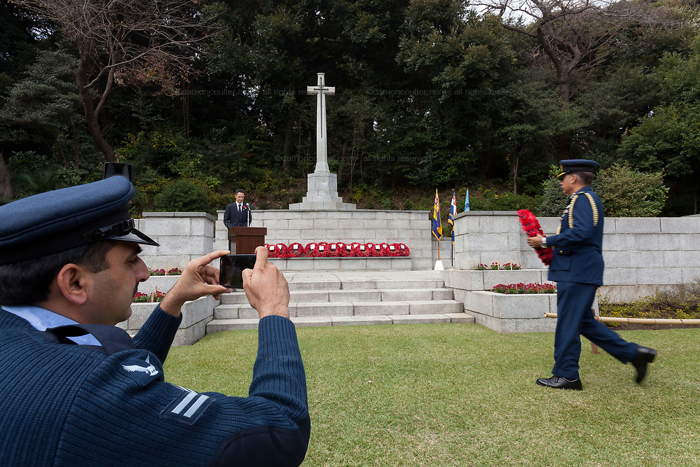 A representative of the the Pakistani military lays a wreath of poppies during the  Remembrance Sunday ceremony at the Hodogaya, Commonwealth War Graves Cemetery in Hodogaya, Yokohama, Kanagawa, Japan. Sunday November 11th 2018. The Hodagaya Cemetery holds the remains of more than 1500 servicemen and women, from the Commonwealth but also from Holland and the United States, who died as prisoners of war or during the Allied occupation of Japan. Each year officials from the British and Commonwealth embassies, the British Legion and the British Chamber of Commerce honour the dead at a ceremony in this beautiful cemetery. The year 2018 marks the centenary of the end of the First World War in 1918.