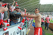 Southampton's Dejan Lovren celebrates with fans at the final whistle after giving his shirt away to young fan.<br /> Barclays Premier league match, Swansea city v Southampton at the Liberty stadium in Swansea, South Wales on Saturday 3rd May 2014.<br /> pic by Phil Rees, Andrew Orchard sports photography.