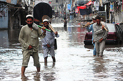 July 13, 2017 - Rawalpindi, Punjab, Pakistan - A view of rain water accumulated on  Road after heavy rain that experienced the Twin Cities Several areas in Rawalpindi including Jamia Masjid Road and Nadeem Colony have been deluged under rainwater Heavy rains lashed the garrison city on Thursday morning flooding low-lying areas of the city inundating streets and roads and causing problems to the residents in several areas The rainfall also raised the water level in the Nullah Leh to 10 feet a level of pre-alert triggering the relevant departments into action If the water rises over 116 feet an alert is sounded The rain flooded streets and roads in Sadiqabad, Raja Bazaar, Arian Mohalla, Javaid Colony, Dhoke Chiragh Din, Satellite Town, Waris Khan and Committee Chowk Rainwater also entered shops and markets in Sadiqabad, along with Jamia Masjid Road, Iqbal Road, and other low-lying areas (Credit Image: © Pacific Press via ZUMA Wire)