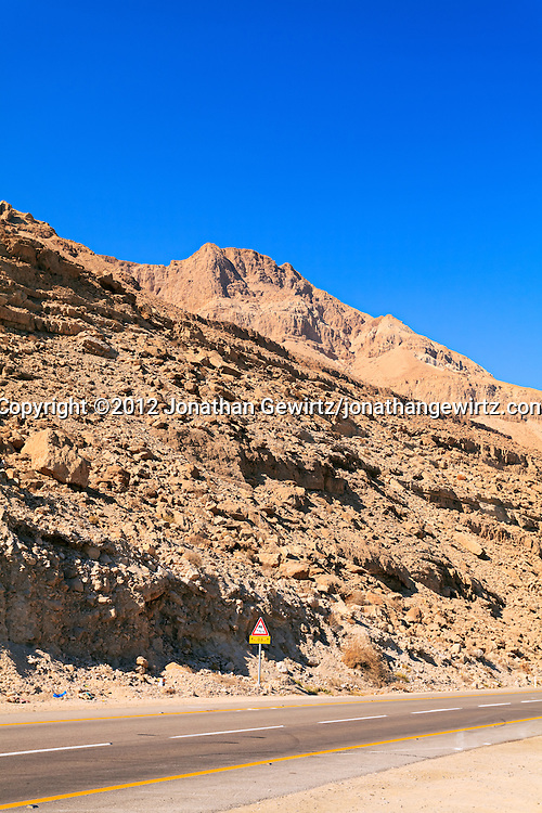 Highway 90 runs along the base of rocky hills on the western Dead Sea coast, Israel. WATERMARKS WILL NOT APPEAR ON PRINTS OR LICENSED IMAGES.