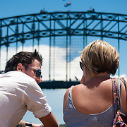 Passengers on ferry taking in the sights of Sydney.