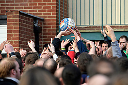 © London News Pictures. 04/03/2014. Ashbourne, UK. The ball is caught by a player. Two teams, the Up'Ards and the Down'Ards, fight for the ball during the first day of the Royal Shrovetide Football match in Ashbourne, Derbyshire. For two days, over Shrove Tuesday and Ash Wednesday, hundreds of participants battle it out in a 'no rules' game dating back to the 17th Century where the aim is to get a ball into one of two goals that are positioned three miles apart at either end of Ashboune. Photo credit: Ben Cawthra/LNP