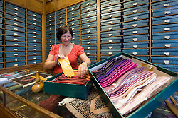 Patsy Sarteel, the owner of the A. Boon Glove shop, organizes her stock, in Antwerp, Belgium, Saturday, Sept. 13, 2008. Sarteel took over the store in 1975 from a family relative. The store has been in her family since 1884. (Photo © Jock Fistick)