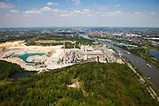 Nederland, Limburg, Gemeente Maastricht, 27-05-2013<br /> Sint-Pietersberg, mergelgroeve voor de winning van mergel (eigenlijk kalksteen) in dagbouw door cementfabriek ENCI. Maastricht aan de horizon. Wat er nog resteert van de St.Pietersberg, rond de groeve, is beschermd natuurgebied en bovengronds en ondergronds aangewezen als beschermd Habitatrichtlijngebied.<br /> Marl quarry for the extraction of marl (limestone actually) in surface mining by cement factory ENCI. Maastricht at the horizon. What is left of the Sint-Pietersberg is designated as protected area, both on groundlvel and underground the habitat directives apply.<br /> luchtfoto (toeslag op standaardtarieven);<br /> aerial photo (additional fee required);<br /> copyright foto/photo Siebe Swart.