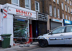 © Licensed to London News Pictures. 09/02/2012. London, UK. A Car skidded on ice and went through a shop window in Wapping, London, this morning 9th February 2012, The car had just left a parking space on the opposite side of the road and went through the shop front of Hussey's,the butchers at 64 Wapping Lane. No one was injured in the incident. The shop front is badly damaged and possibly structurally damaged. Police confirmed they got call around 6am and attended the scene, ambulance crews also attended. Photo credit : Vickie Flores/LNP
