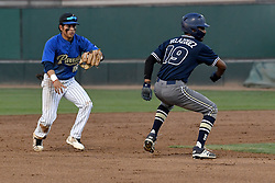 May 23, 2019 - Los Angeles, California, U.S. - Birmingham's Salvador Velazquez #19 is run down and tagged out by Poly's Cristian Ruiz #18 during their L.A. City Section semifinal game at Dedeaux Field on the USC campus in Los Angeles Thursday, May 23, 2019. (Credit Image: © Hans Gutknecht/SCNG via ZUMA Wire)
