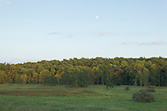 Vernon, New Jersey - The moon rises above the trees at sunset in a view from the Pochuck Boardwalk section of the Appalachian Trail on Aug. 28, 2012.