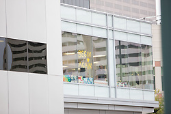 August 14, 2017 - Denver, Colorado, U.S - A new sign on the window of a building across the street ''Begin Again'' at the end of the Taylor Swift Groping Trial against radio DJ David Mueller at the Alfred A. Arraj United States Courthouse. She won her counter-suit. (Credit Image: © Matthew Staver via ZUMA Wire)