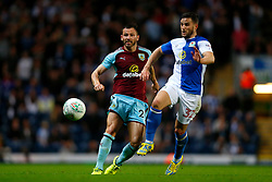 Blackburn Rovers' Craig Conway (right) in action with Burnley's Phillip Bardsley during the Carabao Cup, Second Round match at Ewood Park, Blackburn.