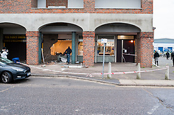 © Licensed to London News Pictures. 21/01/2016 Essex, UK. Workers begin the clean up after thieves used a JCB to ram raid a Barclays Bank at Honywood Road, Basildon about 1.25am this morning. It is not sure what has been taken at this stage and the JCB is still outstanding. Photo credit : Simon Ford/LNP