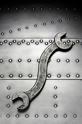 S-wrench on metal riveted steel plate