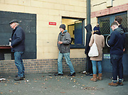 Supporters que for hot drinks during the Dulwich Hamlet F.C. game vs Lowestoft Town F.C. at Champion Hill on 25th October 2017 in South London in the United Kingdom. Dulwich Hamlet was founded in 1893 and both teams play in the Isthmian League Premier Division, a regional mens football league covering London, East and South East England.