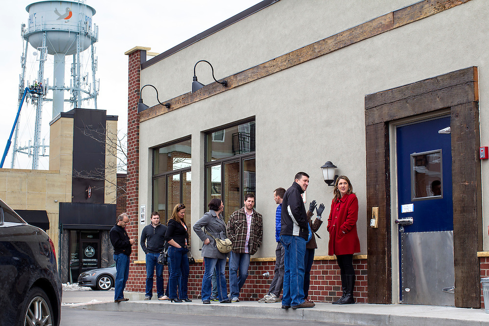 Guests line up for a Friday night 5pm opening at Travail and The Rookery in Robbinsdale April 18, 2014.