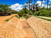 02 JUNE 2016 - SIEM REAP, CAMBODIA: What's left of an irrigation canal and water source west of Siem Reap. Local people said that at this time of year, the canal should be about 1/3 to 1/2 full. Cambodia is in the second year of  a record shattering drought, brought on by climate change and the El Niño weather pattern. Farmers in the area say this is driest they have ever seen their fields. They said they are planting because they have no choice but if they rainy season doesn't come, or if it's like last year's very short rainy season they will lose their crops. Many of the wells in the area have run dry and people are being forced to buy water to meet their domestic needs.     PHOTO BY JACK KURTZ