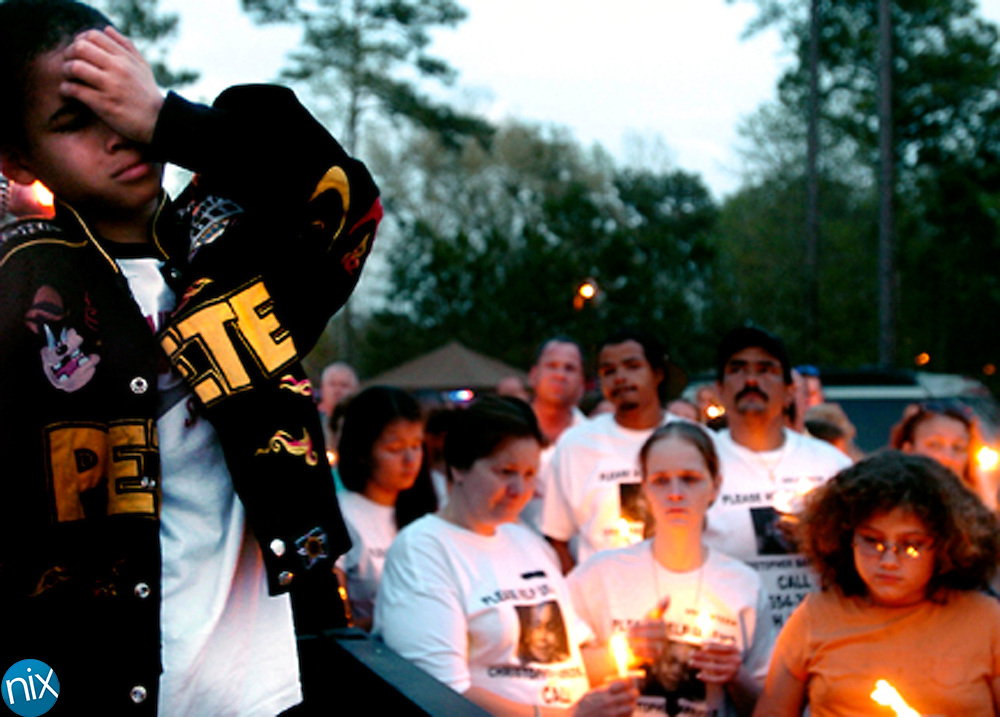 """The Search for Christopher Barrios Jr.: Brevin Barrios, 10, cries after addressing a crowd of well-wishers and asking them to bring home his brother, six-year-old Christohpher Barrios Jr., during a candle-light vigil Wednesday, March 14, at the Barrios search volunteer station off of Canal Road in Brunswick. Brevin told the crowd """"if you see my brother, tell him to come home."""""""