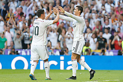 25.10.2014, Estadio Santiago Bernabeu, Madrid, ESP, Primera Division, Real Madrid vs FC Barcelona, 9. Runde, im Bild Real Madrid´s Cristiano Ronaldo celebrates a goal with James // during the Spanish Primera Division 9th round match between Real Madrid CF and FC Barcelona at the Estadio Santiago Bernabeu in Madrid, Spain<br /> <br /> ***** NETHERLANDS ONLY *****
