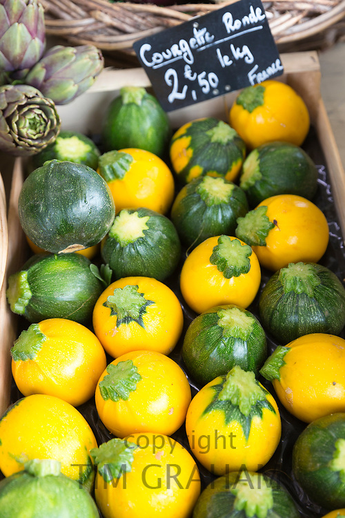 Artisan French courgettes ( squash ) among fresh vegetables on sale at street market Bordeaux, France