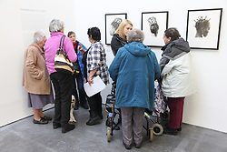 Visually impaired people at photography exhibition at Nottingham Art Exchange