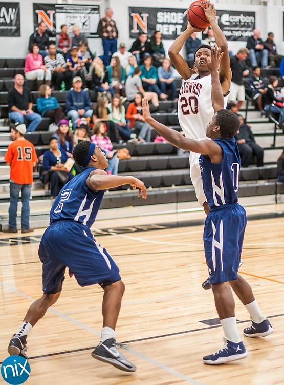 Northwest Cabarrus' Tyree Cummings takes a shot against Hickory Ridge Thursday night at Northwest Cabarrus High School. Northwest won the game 72-69.