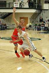 17 November 2015:  Brady Rose(15) strides past Michael Hohm during an NCAA men's division 3 CCIW basketball game between the Greenville College Panthers and the Illinois Wesleyan Titans in Shirk Center, Bloomington IL