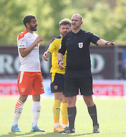 Blackpool's Kevin Stewart and Oxford United's Matty Taylor appeal to referee Robert Madley<br /> <br /> Photographer Rob Newell/CameraSport<br /> <br /> Sky Bet League One Play-Off Semi-Final 1st Leg - Oxford United v Blackpool - Tuesday 18th May 2021 - Kassam Stadium - Oxford<br /> <br /> World Copyright © 2021 CameraSport. All rights reserved. 43 Linden Ave. Countesthorpe. Leicester. England. LE8 5PG - Tel: +44 (0) 116 277 4147 - admin@camerasport.com - www.camerasport.com