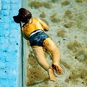woman model swimming at bekonscot model village.