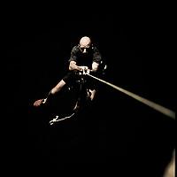 Jose Pereyra ascends rope above Nam Ou River, Ban Pak Ou, Luang Phrabang, Laos