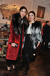 Left to right, CAROLINE ISSA and LARA BOHINC at a party to celebrate thelaunch of Alice Temperley's flagship store Temperley, Bruton Street, London on 6th December 2012.