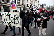 London, UK. Saturday 20th October 2012. Members of the Balck Bloc anarchists group confuse cause confusion in central London during the TUC (Trades Union Congress) march 'A Future That Works'. Demonstration against austerity cuts by the government.