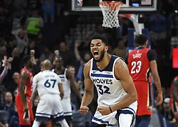 November 14, 2018 - Minneapolis, MN, USA - The Minnesota Timberwolves' Karl-Anthony Towns (32) celebrates a fourth-quarter dunk by teammate Andrew Wiggins, with an and-one opportunity against the New Orleans Pelicans on Wednesday, Nov. 14, 2018, at Target Center in Minneapolis. The Timberwolves won, 107-100. (Credit Image: © Aaron Lavinsky/Minneapolis Star Tribune/TNS via ZUMA Wire)