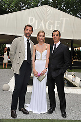 Left to right, designer PATRICK GRANT, SASHA PIVOVAROVA and PHILIPPE LEOPOLD METZGER CEO of Piaget at a garden party hosted by Piaget at The Hempel Hotel, London on 14th July 2011.
