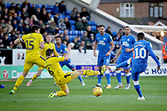 Peterborough United midfielder Siriki Dembele (10) shot is blocked during the EFL Sky Bet League 1 match between Peterborough United and Oxford United at London Road, Peterborough, England on 8 December 2018.