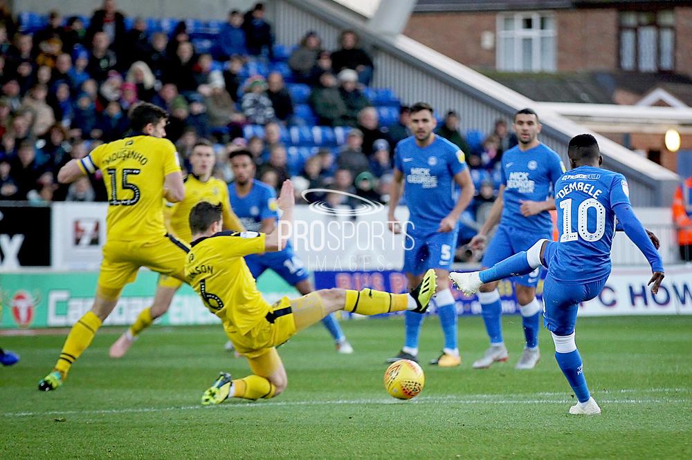 Peterborough United midfielder Siriki Dembele (10) shot is blocked during the EFL Sky Bet League 1 match between Peterborough United and Oxford United at London Road, Peterborough, England on 8 December 2018.