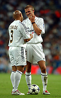 Photo. Daniel Hambury.<br />UEFA Champions League. 2nd leg qualifier. 25/8/2004<br /><br />Real Madrid V Wisla Krakow<br /><br />Real Madrid's David Beckham and Roberto Carlos discuss who should take a free kick