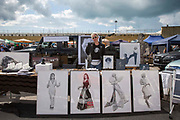 Artist Nina Mae Fowler selling her work at the 2017 Art Car Boot Fair, Folkestone, Kent.
