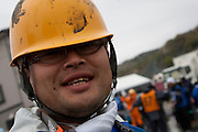 Portrait of a Peace boat volunteer after taking part in the clean-up operations in Ishinomaki, Miyagi Friday May 6th 2011. Around 350 volunteers took part in the relief effort over the Golden Week holiday, including 41 foreigners, clearing mud and removing debris from this coastal town which more almost levelled in the March 11th earthquake and tsunami.