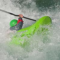 Kayaker Peter Thompson paddles through rapids in the Kananaskis River near Calgary, Alberta, Canada.