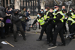 © Licensed to London News Pictures. 03/04/2021. London, UK. Protesters take part in a demonstration in Hyde Park against the Government's proposed Police, Crime, Sentencing and Courts Bill remonstrate with police officers after a Macdonald's delivery truck got caught up in Parliament Square. Photo credit: Ray Tang/LNP