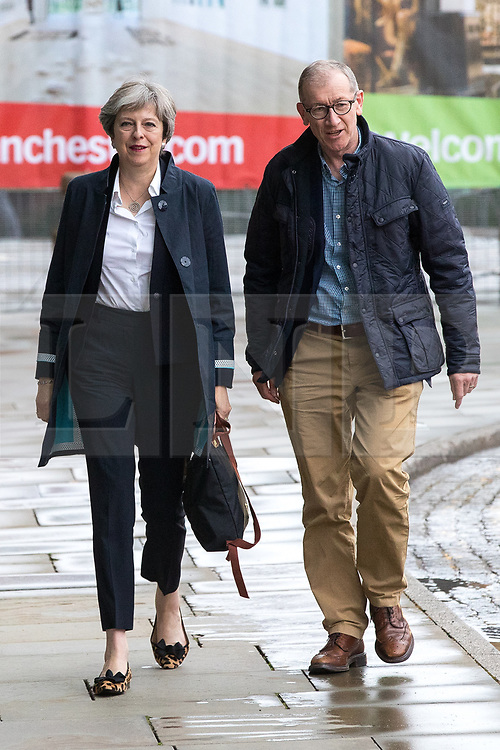 © Licensed to London News Pictures . 30/09/2017. Manchester, UK.  Prime Minister THERESA MAY and husband PHILIP MAY arrive at the Midland Hotel as Manchester prepares for the Conservative Party Conference , which is taking place inside a secured zone around the Manchester Central Convention Centre . Photo credit: Joel Goodman/LNP
