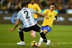 June 9, 2017 - Melbourne, Victoria, Australia - GABRIEL MERCADO (2) of Argentina and PHILIPPE COUTINHO (11) of Brazil compete for the ball in an international friendly match between Brazil and Argentina at the Melbourne Cricket Ground on June 10, 2017 in Melbourne, Australia. Argentina won 1-0 (Credit Image: © Sydney Low via ZUMA Wire)