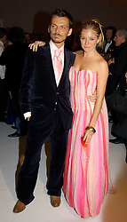 MATTHEW WILLIAMSON and SIENNA MILLER at the Moet & Chandon Fashion Tribute 2005 to Matthew Williamson, held at Old Billingsgate, City of London on 16th February 2005.<br /><br />NON EXCLUSIVE - WORLD RIGHTS