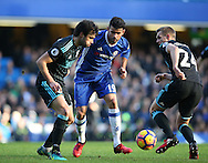 Chelsea's Diego Costa tussles with WBA's Claudio Jacob and Darren Fletcher during the Premier League match at Stamford Bridge Stadium, London. Picture date December 11th, 2016 Pic David Klein/Sportimage