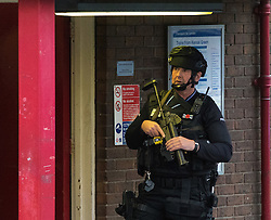 "Kensal Green, London, May 31st 2016. Police in body armoured protective headgear seal off Kensal Green tube station in North West London in what is described as a ""security incident"". PICTURED: An armed officer outside the station entrance."