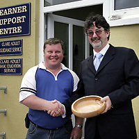 John Ryan shows his appreciation to Tom Hopkins for coming down to Kilrush to open the new Learner Support Centre offices as he presents him with a hand crafted wooden bowl.<br /> <br /> Photograph by Yvonne Vaughan.